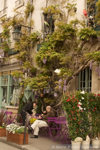 A Colorful Sidewalk Cafe In Paris